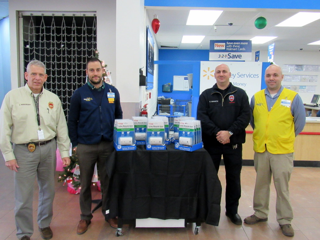 James Mercready, Chief of the Township's Fire Prevention Bureau, Walmart Manager Bryan Deily, Toms River Fire Lead Fire Inspector Kevin Esposito, Walmart Associate Randall Stirewalt (Photo: Stacy Proebstle)
