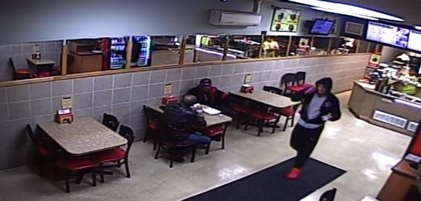 A man swiping $100 from a tip jar at a Toms River restaurant. (Photo: TRPD)