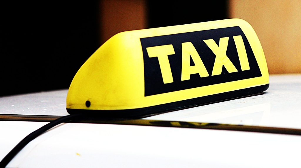 A taxi sign. (Credit: Leonid Mamchenkov/ Flickr)