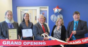 Mayor Thomas Kelaher cutting the ribbon at the TR Post Office's Passport Center, Sept. 2017. (Photo: Toms River Township)