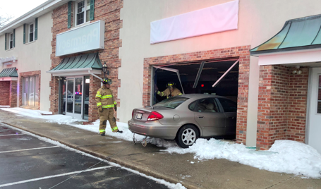 A car plows into a building in Toms River, Jan. 10, 2017. (Photo: TRPD)