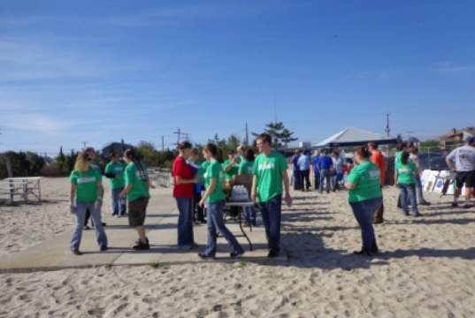 Volunteers clean up a Toms River beach during one of several annual beach sweeps. (Photo: Toms River Twp.)