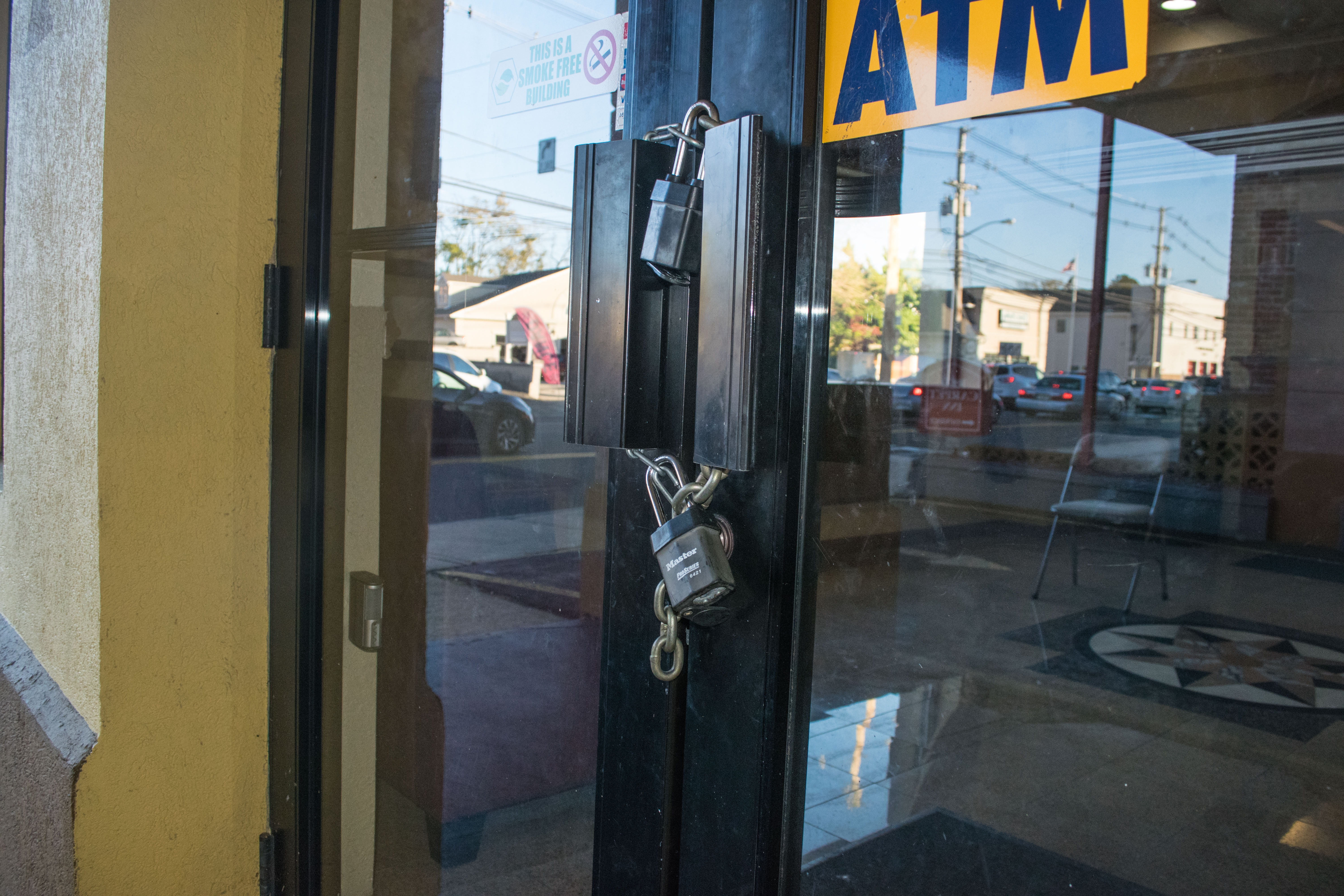 A chain and lock on the door of the Red Carpet Inn after being purchased by the municipal government of Toms River, Oct. 29, 2018. (Photo: Daniel Nee)