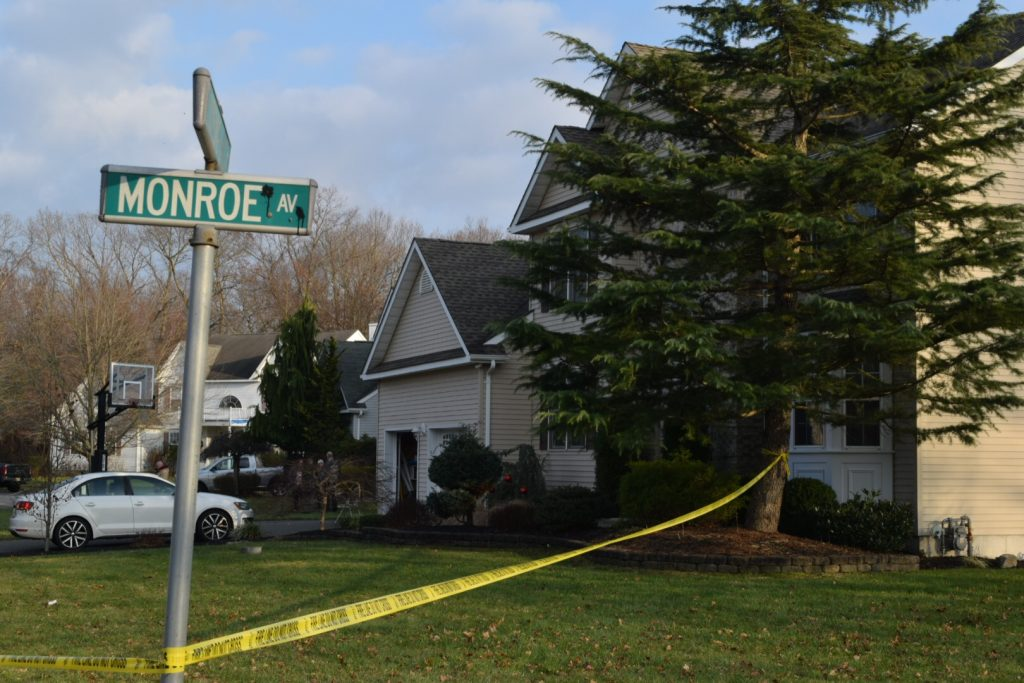 Police caution tape surrounding a home where a fire was reported, Dec. 13, 2018. (Photo: Daniel Nee)