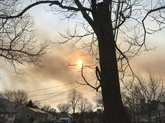 Smoke from the forest fire pillows near the joint base Saturday, March 30, 2019. (Photo: Daniel Nee)