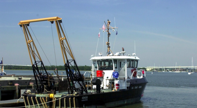 A 49-foot stern-loading buoy tender, better known as a BUSL, sits moored at a Coast Guard station. (Coast Guard Photo: Telfair H. Brown, Sr.)