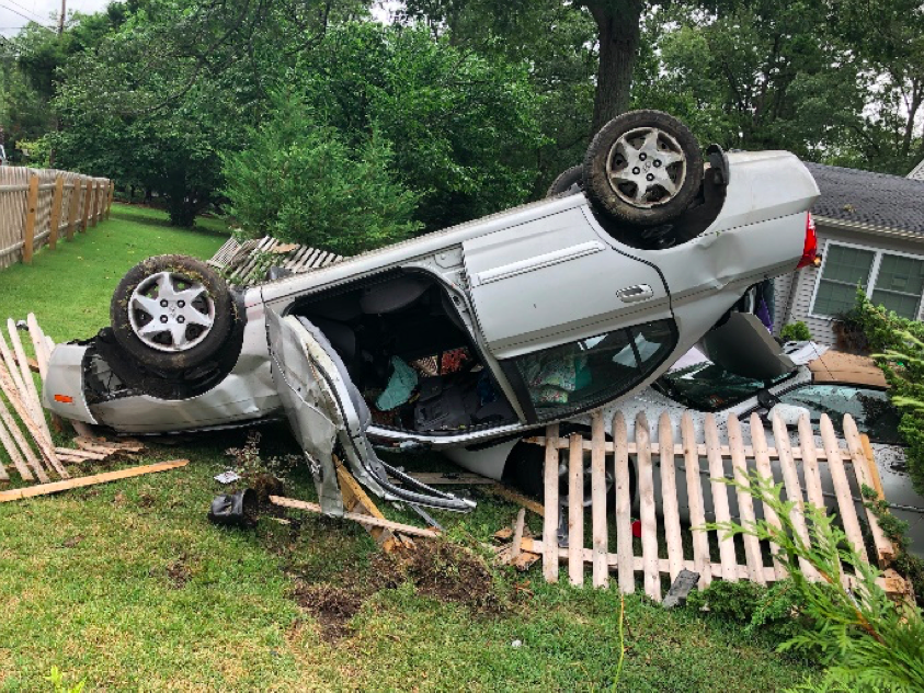 A vehicle landed on top of another after hitting a curb in Toms River. (Photo: TRPD)