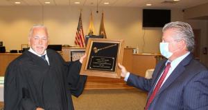 Judge James J. Gluck presents an award to his predecessor, Judge James A. Ligouri. (Photo: Ocean County Prosecutor's Office)