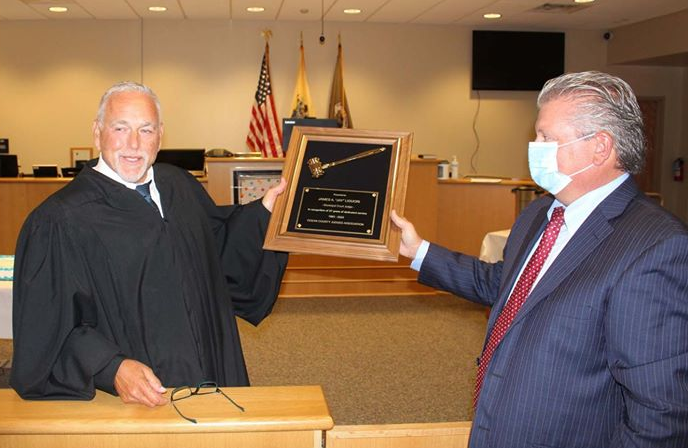 Judge James J. Gluck presents an award to his predecessor, Judge James A. Ligouri. (Photo: Ocean County Prosecutor's Office)