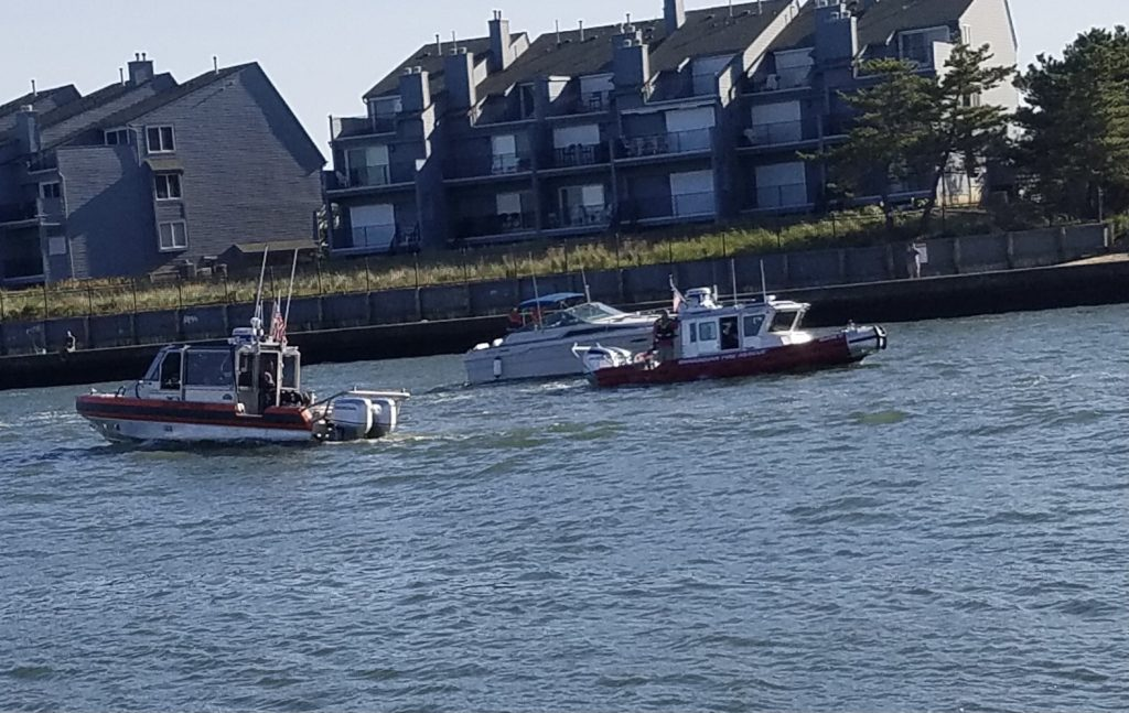 A boat is disabled and secured by the U.S. Coast Guard and Brielle Fire-Rescue in Manasquan Inlet, Sept. 22, 2020. (Photo: Patricia Nee)