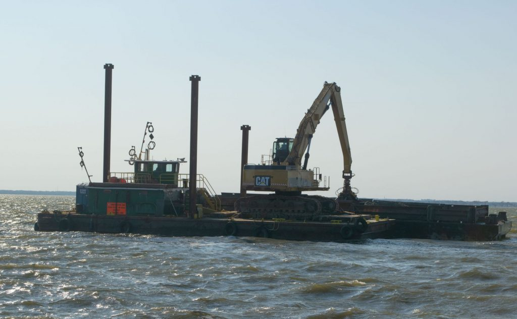 A dredge boat empties material at Bayside Park, Oct. 2020. (Photo: Daniel Nee)