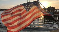 An American flag against a sunset. (Photo: Daniel Nee)