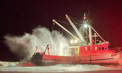 A commercial fishing vessel, Bear, grounded at Island Beach State Park, Oct. 10, 2021. (Credit: Seaside Park Fire Dept.)
